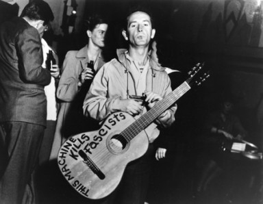 Woody_Guthrie_This_Machine_Kills_Fascists